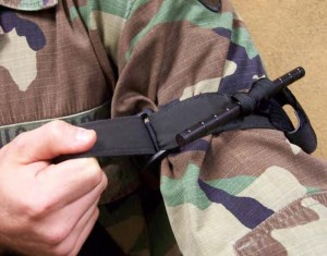 Figure 2-15. Pull the free-running end of the self-adhering band tight and securely fasten it back on itself.