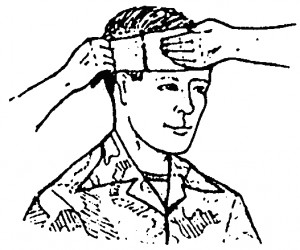 Figure 5-2. Wrapping a tail horizontally around the head (wound on forehead).