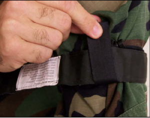 Figure 2-20. Grasp the windlass strap, pull it tight, and adhere it to the Velcro on the windlass clip.